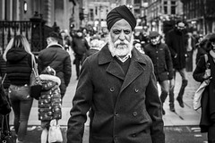 Buchanan Street (Leanne Boulton) Tags: urban street candid portrait portraiture streetphotography candidstreetphotography candidportrait streetportrait eyecontact candideyecontact streetlife man male face eyes expression mood beard turban sikh coat style fashion stylish tone texture detail depthoffield bokeh crowd naturallight outdoor light shade city scene human life living humanity society culture lifestyle people canon canon5dmkiii 50mm primelens ef50mmf14usm black white blackwhite bw mono blackandwhite monochrome glasgow scotland uk