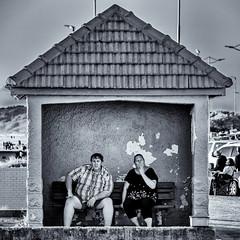 ...and sometimes we just sit (Steve Crane) Tags: bw blackwhite blackandwhite helderberg southafrica strand westerncape beach building decay man monochrome people street woman women