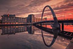 Clyde Sunrise (raymond_carruthers) Tags: morning clydearc sunrise scotland bridge river riverclyde hotel reflections hiltongardeninn scottish squintybridge longexposure apartments glasgow