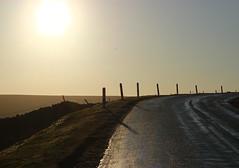 brow of the bank (kokoschka's doll) Tags: road sun sky morning post shadow bank hill bollihope weardale pennines