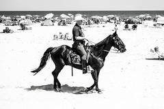 Law and Order at the Beach (KidArkon) Tags: beach horse law officer bw blackandwhite nh newhampshire new hampshire seacoast resort fineart