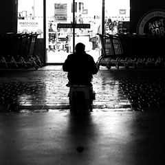 In front of the exit (pascalcolin1) Tags: paris13 homme man nuit night caisse box pluie rain reflets reflection shade ombre lumière light exit sortie photoderue streetview urbanarte noiretblanc blackandwhite photopascalcolin 50mm canon50mm canon