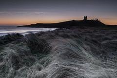Dunstanburgh Castle (osedok) Tags: view castle turistic beach landscape hour outdor scenic golden sunrise photography water england colours northumberland unitedkingdom