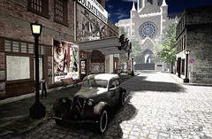 WWII - Cobblestone Street of Entertainment (Raging Bellls) Tags: secondlife war wwii 1940s cityscape ragingbellls cathedral church vintage car theatre theater posters automobile antique