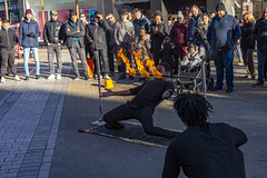 20200119_LeedsGenMix4Jan2020_6877crop (ShakeyDave) Tags: leeds west yorkshire d750 nikon 2020 winter january city centre street performer fire limbo sunshine
