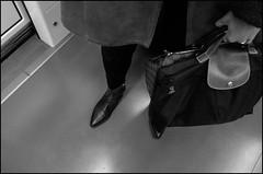 Two bags (GColoPhotographer) Tags: bag bw topdown metro bianconero feet woman blackandwhite ricoh streephotography