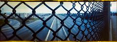 Highway 101 (bior) Tags: highway101 us101 overpass chainlinkfence 6x17 6x17cm pinhole realitysosubtle expiredfilm mediumformat panorama highway longexposure portra400nc kodakportra