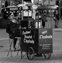 20200119_LeedsGenMix4Jan2020_6852bw2 (ShakeyDave) Tags: leeds west yorkshire d750 nikon 2020 winter january city centre chestnuts briggate man selling stand hot history street seller