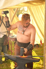Double hammer action (radargeek) Tags: 2019 april norman normanmedievalfaire2019 medievalfair oklahoma beard tattoo hammer blacksmith blacksmithing anvil fire metal