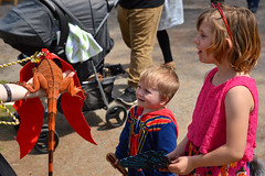 Impressed by the small dragon (radargeek) Tags: 2019 april norman normanmedievalfaire2019 medievalfair oklahoma child children kid kids dragon lizard cat ears spiderman wings iguana