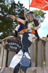 A mermaid preparing to send a gift (radargeek) Tags: 2019 april norman normanmedievalfaire2019 medievalfair oklahoma playground mermaid flag