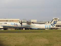 Photo of G-ECOF Dash-8 departing Cardiff