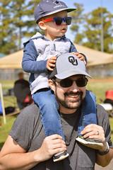 A ride on dad's shoulders (radargeek) Tags: 2019 april norman normanmedievalfaire2019 medievalfair oklahoma child children kid kids shoulderride sunglasses hat