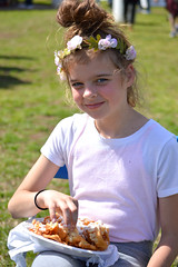 A funnel cake fan (radargeek) Tags: 2019 april norman normanmedievalfaire2019 medievalfair oklahoma child children kid kids flowers hair funnelcake