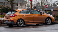 2017 Chevrolet Cruze (mlokren) Tags: 2020 car spotting photo photography photos pic picture pics pictures pacific northwest pnw pacnw oregon usa vehicle vehicles vehicular automobile automobiles automotive transportation outdoor outdoors gm general motors chevy 2017 chevrolet cruze hatch hatchback orange copper
