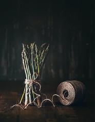 Asparagus (Ro Cafe) Tags: stilllife vegetables asparagus string green darkmood light textured nikkor105mmf28 sonya7iii twine