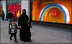 `2862 (roll the dice) Tags: london westend w1 westminster surreal people fashion oxfordstreet mad sad fun funny smile happy angry reaction streetphotography cold colour words canon tourism tourists urban england unaware unknown uk classic art sexy pretty girls portrait strangers candid wisdom natural eyes face shops shopping shock veiled banned muslim burka niqab kid selfridges gay decade rainbow arab advertising