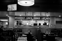 Late Nite  (Fuji Acros) (Harald Philipp) Tags: xtol rangefinder rollei35 sonnar 40mm primelens usa diner restaurant dennys latenite haraldphilipp indoors fujifilm acros iso100 iso60 film grain analog analogue filmphotography 35mm 135 monochrome bw blackandwhite solitude quiet dark night nightshot waikiki honolulu oahu