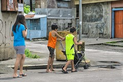 You push, I'll follow. (Beegee49) Tags: street people woman filipina boys pushchair happyplanet sony a6000 bacolod city philippines asia