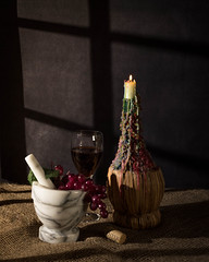 Candlelight Still LIfe (lclower19) Tags: chianti bottle candleholder mortar pestle wine grapes cork 1202020 19 tabletop 352 522020 sb600 bogo