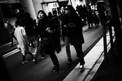 Joy of life (ademilo) Tags: street streetphotography streetlight crowd city cityscape citylife contrast monochrome monotone blackandwhite pedestrians people pedestrian pavement passer tokyo town townscape