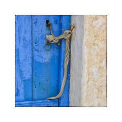 Avlona near Olympos (My digital Gallery) Tags: karpathos greece dodekanes griechischeinseln greekislands griechenland avlona europe eu door blue detail ribbon band blau gelb yellow tür