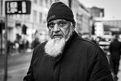 Eye to Eye (Leanne Boulton) Tags: urban street candid portrait portraiture streetphotography candidstreetphotography candidportrait streetportrait eyecontact candideyecontact streetlife old man male face eyes expression mood emotion feeling beard beanie hat intense powerful strong tone texture detail depthoffield bokeh naturallight outdoor light shade city scene human life living humanity society culture lifestyle people canon canon5dmkiii 70mm ef2470mmf28liiusm black white blackwhite bw mono blackandwhite monochrome glasgow scotland uk
