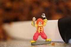 Crazy Clown defending the Christmas cake.  IMG_1806 (alisonhalliday) Tags: cake clown food sweet miniature macro closeup canoneosrp canonef100mmf28lmacroisusm