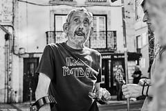 Conversation (rainerneumann831) Tags: bw blackwhite street streetscene ©rainerneumann urban monochrome candid city streetphotography blackandwhite mann lisboa lissabon