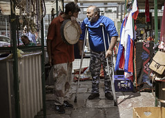 Flea market scene (Braca Stefanovic) Tags: antiquities authentic candid city casual crutches daily diversity europe folks knickknack life marketplace mess people person real scene shade spontaneous stall streetphotography summer urban trade variety venders bracastefanovic belgrade serbia gypsy men