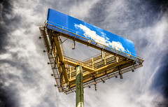 Substitution. (Igor Danilov Philadelphia) Tags: advertisement city philadelphia billboard sky blue gray screen picture above high