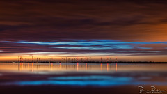 Wonderful start of Blue Monday (BraCom (Bram)) Tags: 169 bracom bramvanbroekhoven goereeoverflakkee grevelingen herkingen holland le nederland netherlands southholland windparkkrammer zuidholland blauw blue bluemonday cloud langesluitertijd lichtjes lights longexposure morning ochtend reflection reflections silhouetten silhouettes sky spiegeling sunrise water widescreen windmill windmills windmolens windturbine wolk zonsopkomst lake meer