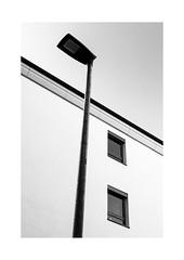 Lined Up (Thomas Listl) Tags: thomaslistl blackandwhite biancoenegro noiretblanc monochrome lantern streetlamp facade windows diagonal geometry geometric lines urban graphical sky architecture 50mm g50