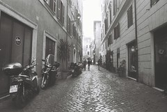 Roma (goodfella2459) Tags: nikonf4 afnikkor24mmf28dlens fomapanprofilineclassic100 35mm blackandwhite film analog city streets street rome italy roma buildings road bwfp
