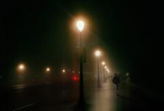 Niebla sobre el puente.   Fog over the bridge (Manuel Peña Jimenez) Tags: niebla noche puente alumbrado madrid fogoverthebridge fog night lighting bridge puentedesegovia foggynight lampposts walker nightwalker sombras shadows