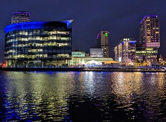 Last evening reflections at Salford Quays at Manchester (Tony Worrall) Tags: city nw northwest north update welovethenorth uk greatbritain england stream tour open place britain country visit location area item attraction english outside outdoors photo shoot shot sale stock picture gb buy british capture sell caught building architecture modern night manchester lights evening glow captured salfordquays illuminated salford instragram ilobsterit wet water reflections bbc studios mediacity