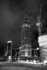 Messeturm (Katzenfutter) Tags: frankfurt messe fair messturm hochhaus skyscraper blackwhite blackandwhite monochrome sigma black white germany deutschland city street lights night freehand hesse hessen