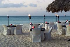 Deluxe Dinner on the Beach (aaronrhawkins) Tags: dinner beach eagle aruba night sunset tiki torch luxury setting sand caribbean sea beautiful romantic vacation aaronhawkins