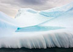 Take a dip, anyone? (tmeallen) Tags: iceberg oldice blueice turquoisepool flutededge takeadip cloudysky higharctic scoresbysund eastgreenland remotearea remotetravel sculpturedice