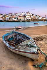 Boat In Ferragudo (dima.travelling) Tags: boat landscape seashore ferragudo algarve portugal summer sunset clouds sand beach rope scenic romantic boats old
