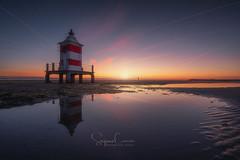 STILL TIDE (Stephen Hunt61) Tags: lighthouse sand reflections sunrise dawn landscapes landscape shoreline coastline seascape seascapes water sky outdoor beach coast marine