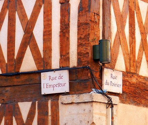 Street names on half-timbered building, Orléans, France.