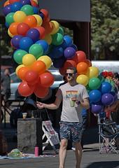 Got Balloons Will Travel (Scott 97006) Tags: guy man baloons colors walk street parade