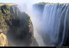 Victoria Falls, Zambia (JH_1982) Tags: victoria falls mosioatunya victoriafälle cataratas chutes 维多利亚瀑布 ヴィクトリアの滝 빅토리아 폭포 виктория smoke thunders rainbow rainbows regenbogen arcoíris arcenciel arcobaleno 彩虹 虹 무지개 радуга wasserfälle wasserfall waterfalls waterfall cascate zambezi river water spray wet landscape nature scenery scenic natur landschaft zambia sambia zambie 赞比亚 ザンビア 잠비아 замбия impressive powerful amazing wonder unesco world heritage