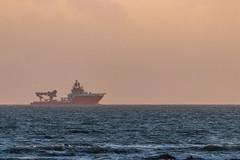 Ship on the horizon (Bridgetony) Tags: sussex blue coastline hazy horizon orange ship
