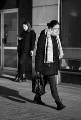 The Separate Thinks... (Last Border of the Picture) Tags: separate things woman old young mature girl smartphone bag shoes building facade cigarette walk stand scarf door glass glasses france europe way foot pedestrian street