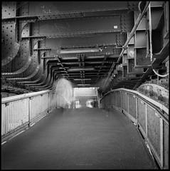 * (Konrad Winkler) Tags: berlin friedrichsstrase unterführung brücke passanten stahl geländer treppe viadukt langzeitbelichtung mittelformat 6x6 ilfordpanfplus hasselblad503cx epsonv800