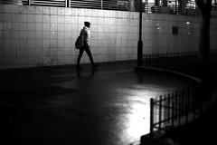 Passing under the lamppost (pascalcolin1) Tags: paris13 homme man nuit night lumière light ombre shade reflets reflection mur wall photoderue streetview urbanarte noiretblanc blackandwhite photopascalcolin 50mm canon50mm canon