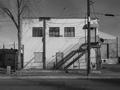 (el zopilote) Tags: albuquerque newmexico industrial street architecture cityscape signs powerlines lumix g9 leicavarioelmarit1260mmf284asph bw bn nb blancoynegro blackandwhite noiretblanc monochrome
