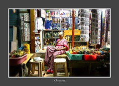 Street photography (Rajavelu1) Tags: art shop lady availablelight creative streetphotography ornaments handheld nightstreetphotography g7xmark2 thisphotorocks artdigital candidstreetphotography handheldnightphotography